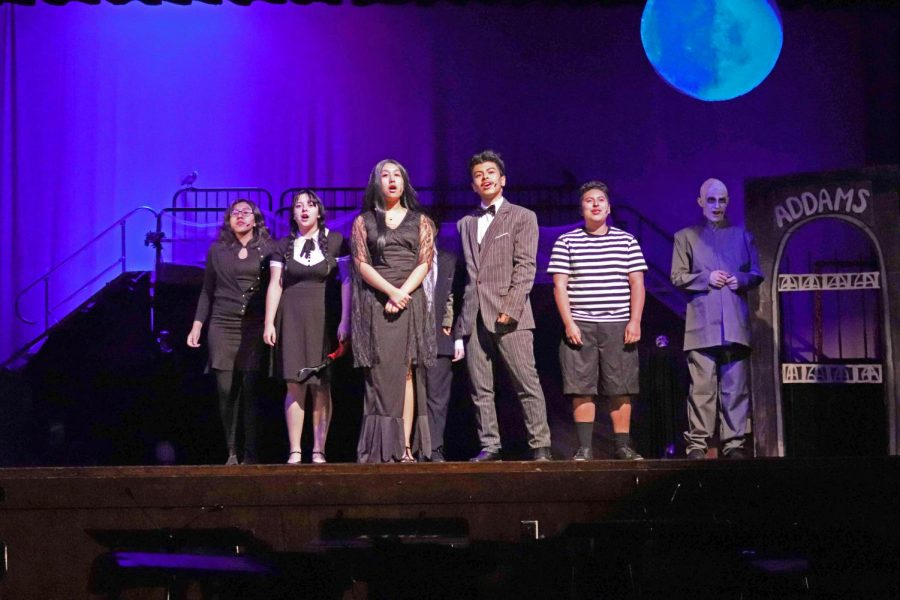 "(From left): Xitalli Solis (Grandma), Estellys Santos (Wednesday). Ariana Gomez (Morticia), Alvin Caceres (Gomez), Justin Aguilar (Pugsley), and Victor Renteria (Uncle Fester) starring in the ""Addams Family,"" a modern take to the original Charles Addams story."