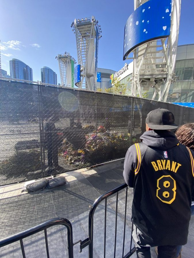 L.A. Live: Fans of Kobe Bryant look in silence at his memorial.