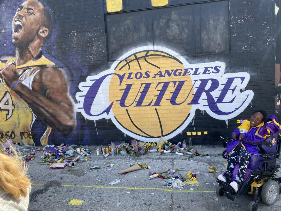 Fan visits a mural in L.A. dedicated to Kobe Bryant.
